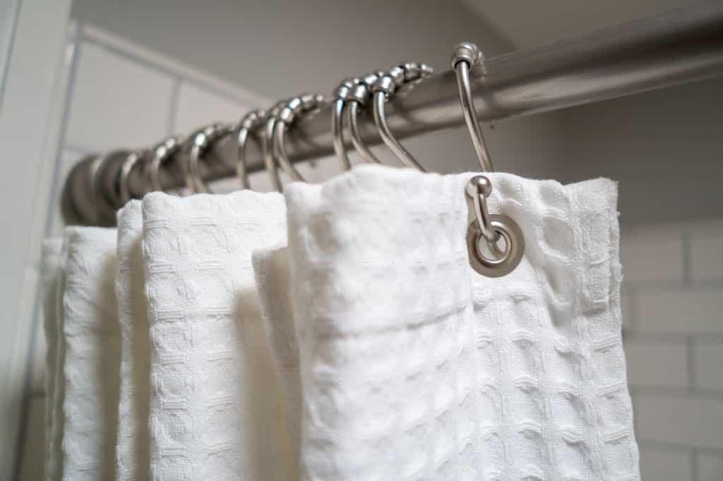 professionals hang curtains
